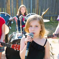 chidren singer girl singing playing live band in backyard