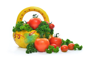 Fresh tomatoes and parsley in basket, isolated on white