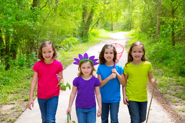 Friends and sister girls walking outdoor in forest track