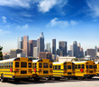 canvas print picture - school bus in a row at LA skyline photo mount