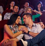 Loving couple embracing in cinema