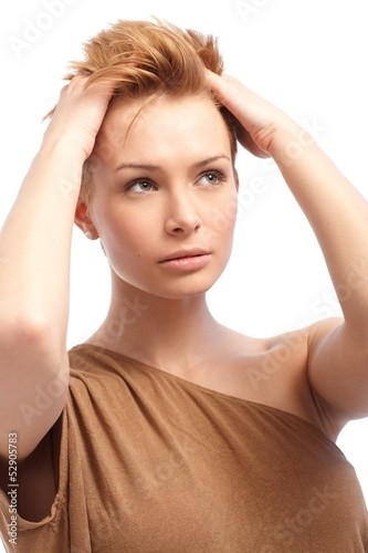Portrait of pretty woman with hand in hair