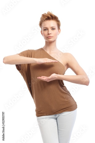 Trendy woman pretending to hold something