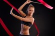 Artistic photo of gymnast with ribbon