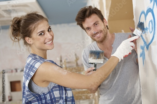 Romantic couple renovating house