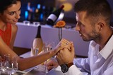 Romantic couple at dinner table