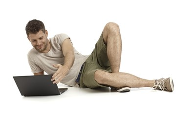 Casual man with laptop computer