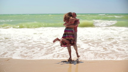 Happy couple in love on the beach
