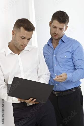 Young businessmen working with laptop computer