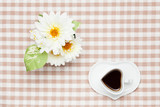 coffee and white artificial flowers