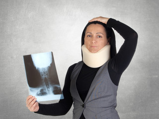 Concerned woman with cervical collar and radiography