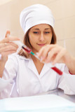 Young nurse with test tube