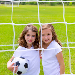 Soccer football kid girls playing on field