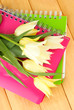 Beautiful white tulips on wooden background