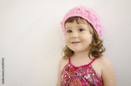 portrait of little girl with pink handmade cap