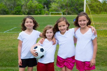 Soccer football kid girls team at sports fileld