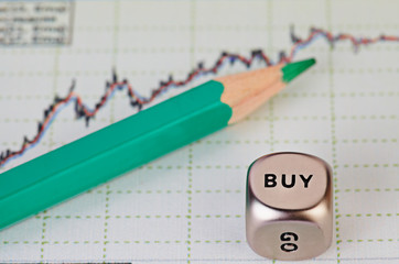 Uptrend financial chart of the stock market,  green pencil and d