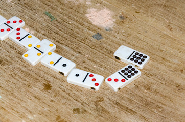 Row of Dominoes in a Table