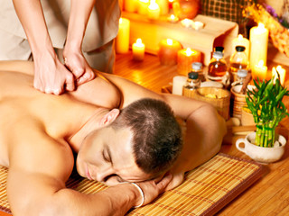Man getting aroma massage in spa.
