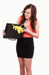 funny picture of young business woman trying to close her briefc