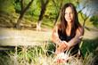 Portrait of the young beautiful smiling woman outdoors, enjoying