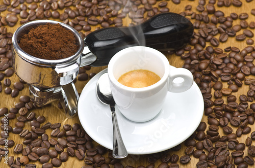 An espresso machine group head with fresh ground coffee