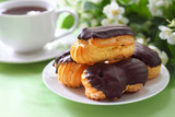 Eclairs with cream in chocolate coating