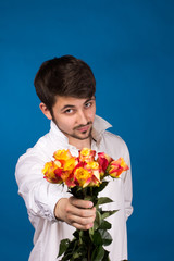 young man giving a red rose