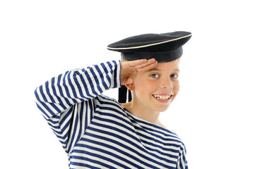 Little sailor  in the sea cap salutes