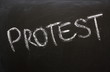 The word Protest on a Blackboard