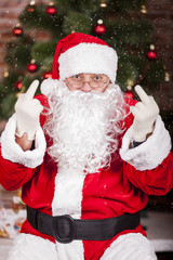 Santa Claus shows the middle finger