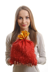 young woman with gift sack, isolated on white