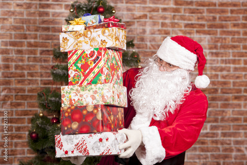 Santa Claus brings Christmas gifts