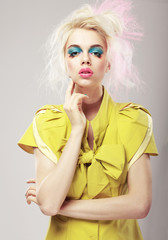 Vivid Blond Hair Woman with  Conspicuous Makeup. Glamor