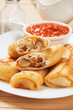 Egg rolls with tomato sauce