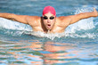 Swimmer athletic man swimming butterfly