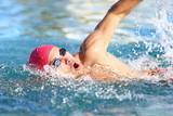 Man swimmer swimming crawl in blue water