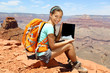 Tablet computer woman hiker hiking in Grand Canyon