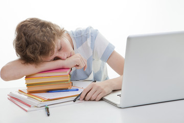 tired student sleeping with homework