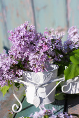 Beautiful , soft lilac in a white vase