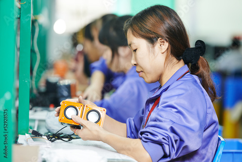 chinese male worker at manufacturing - 52928575