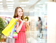 Beautiful young woman with shopping bags