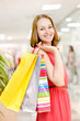 Beautiful young woman with shopping bags in mall