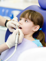 little girl  with open mouth during drilling treatment at the de