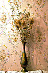 vase with dry grass and thorn still life
