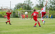 boys  kicking football