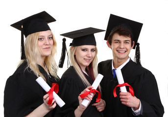 Three graduates holding scrolls