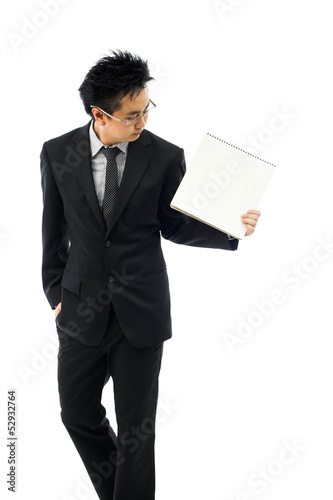 Businessman holding blank book