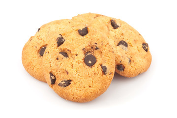 Pile of delicious cookies with chocolate chips on white