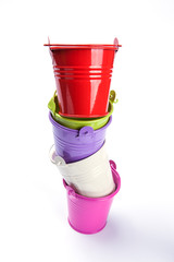 colorful bucket stack onwhite background